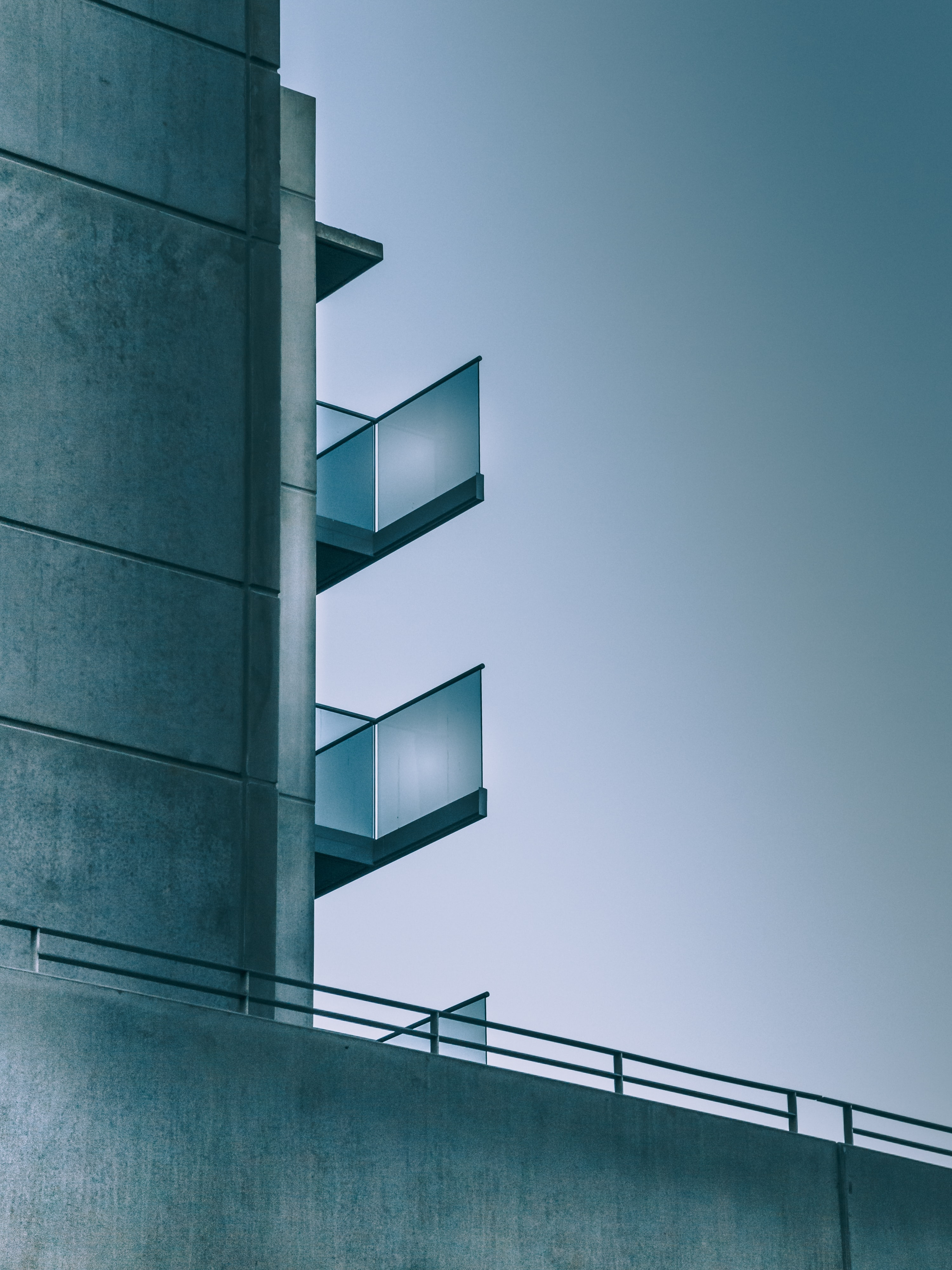 Balconies on a concrete residential building seen from the side