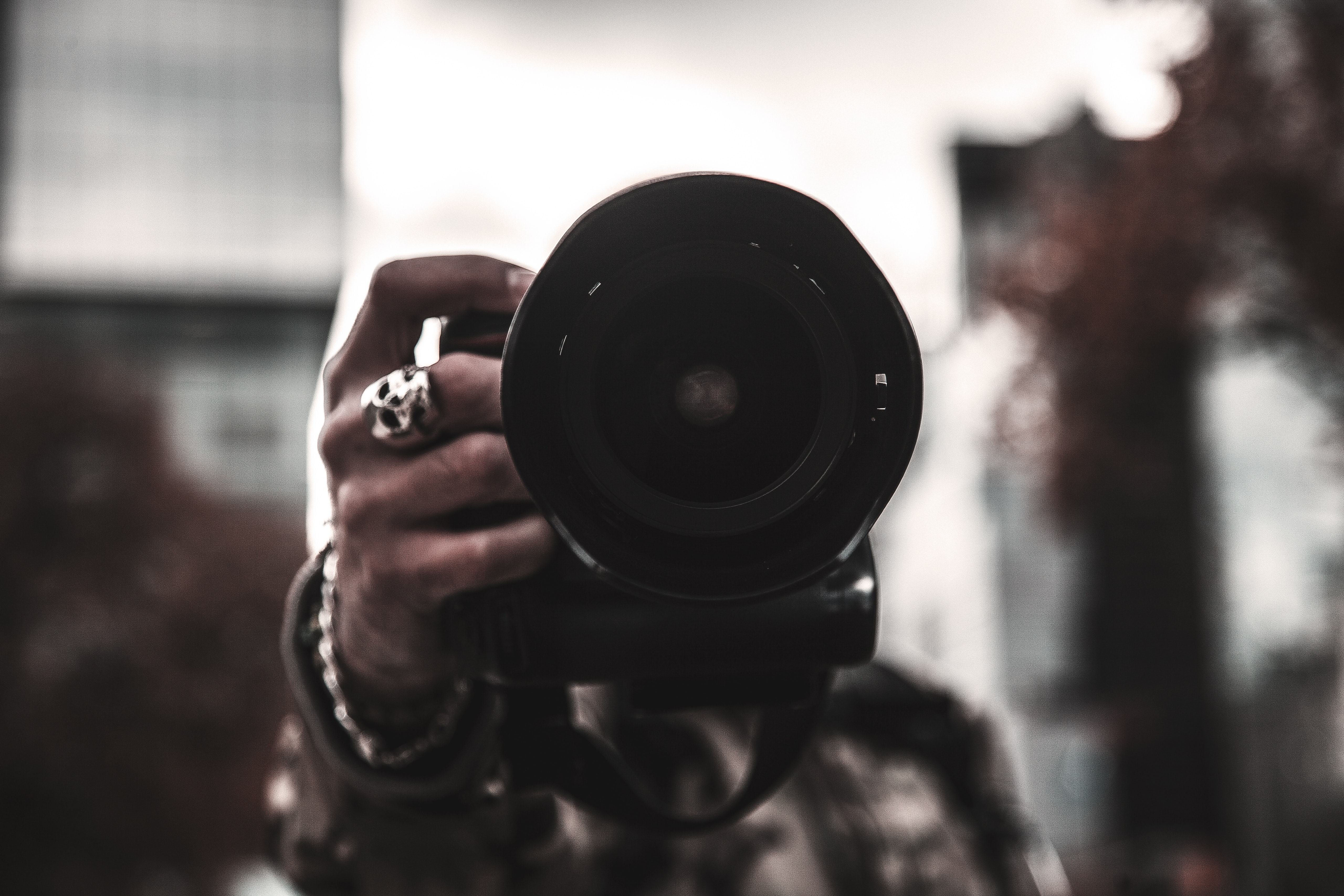 selective focus photo of person holding camera