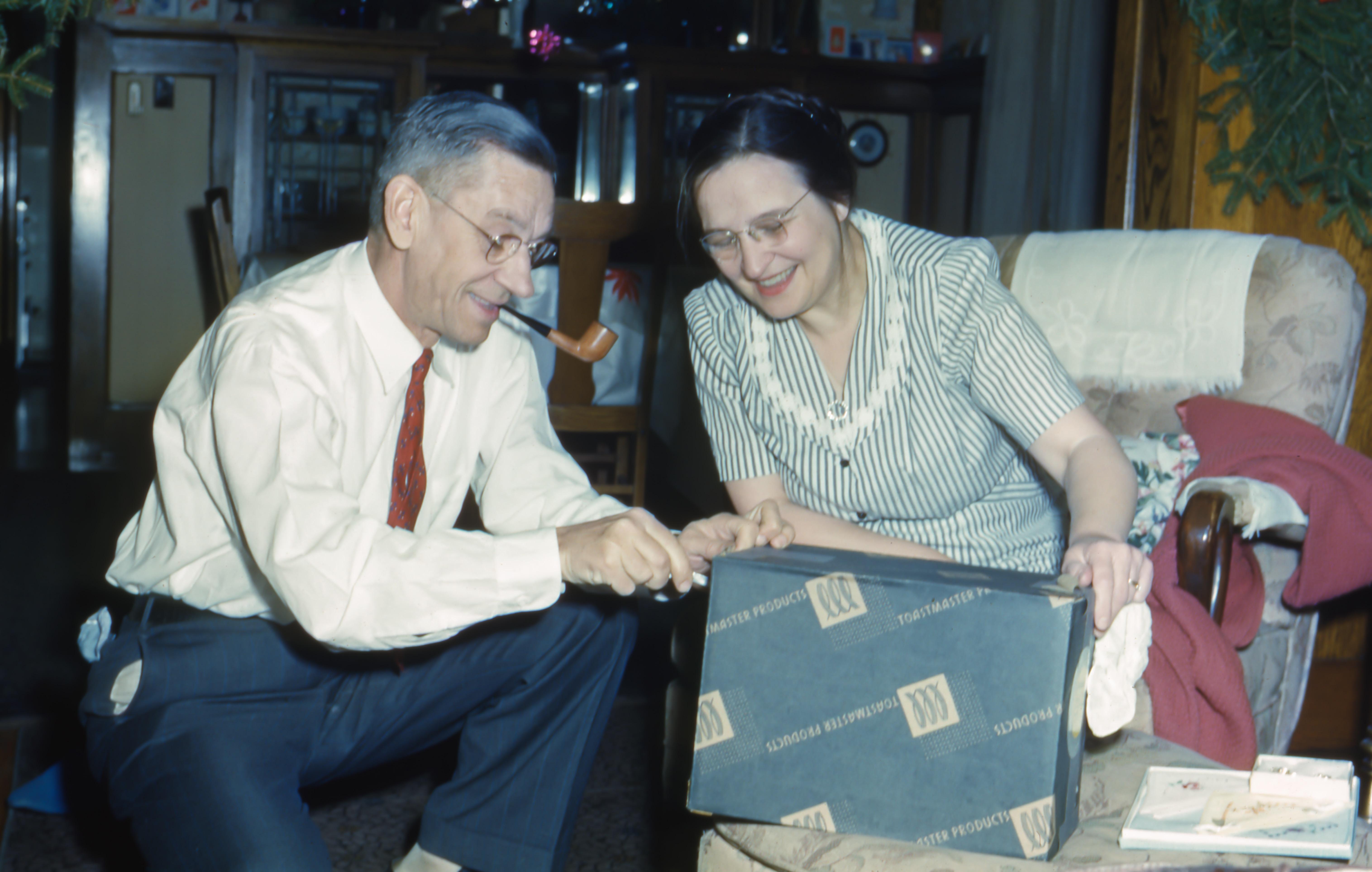man and woman holding black box
