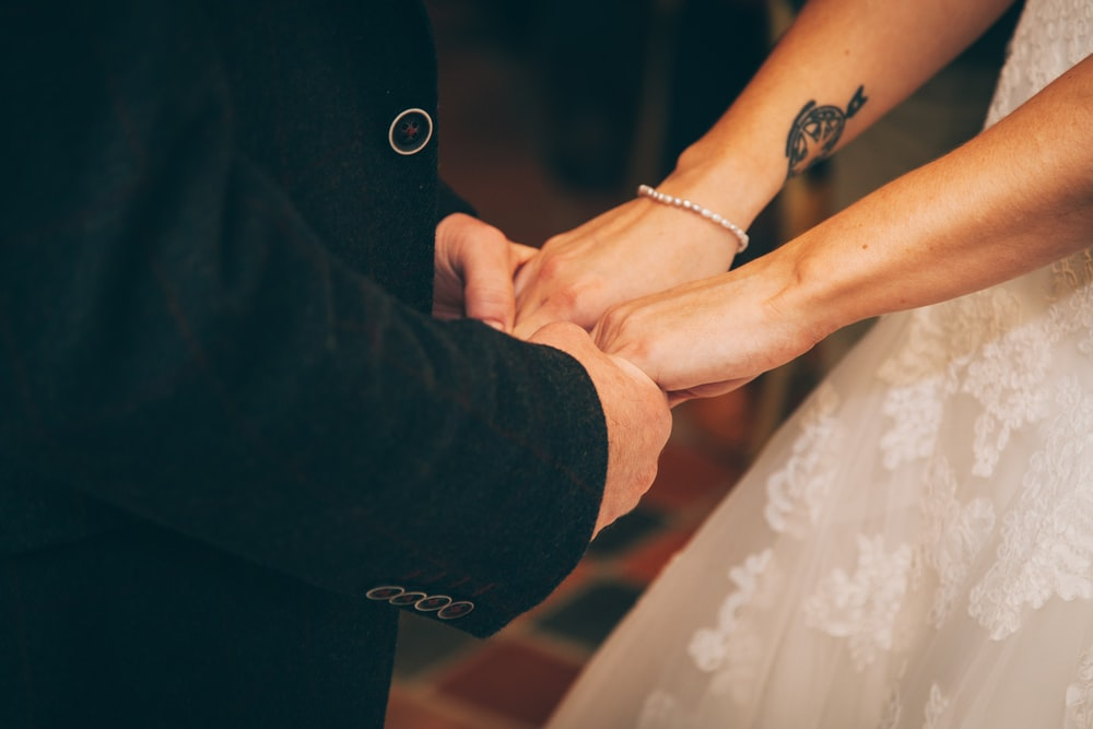 man and woman holding each others hand