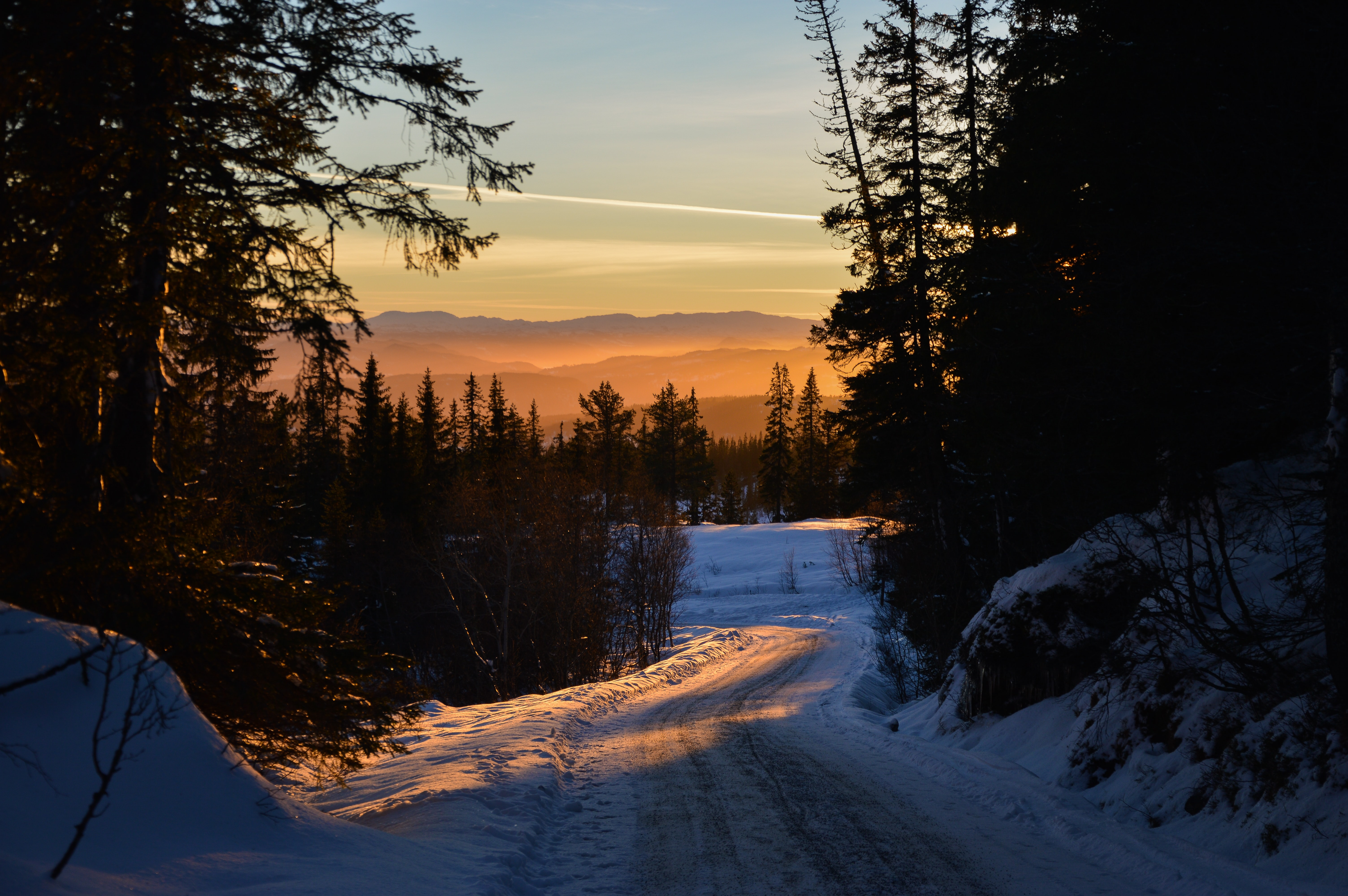 Sunset on the roads of Gråkallen, Norway's snowy forest mountains