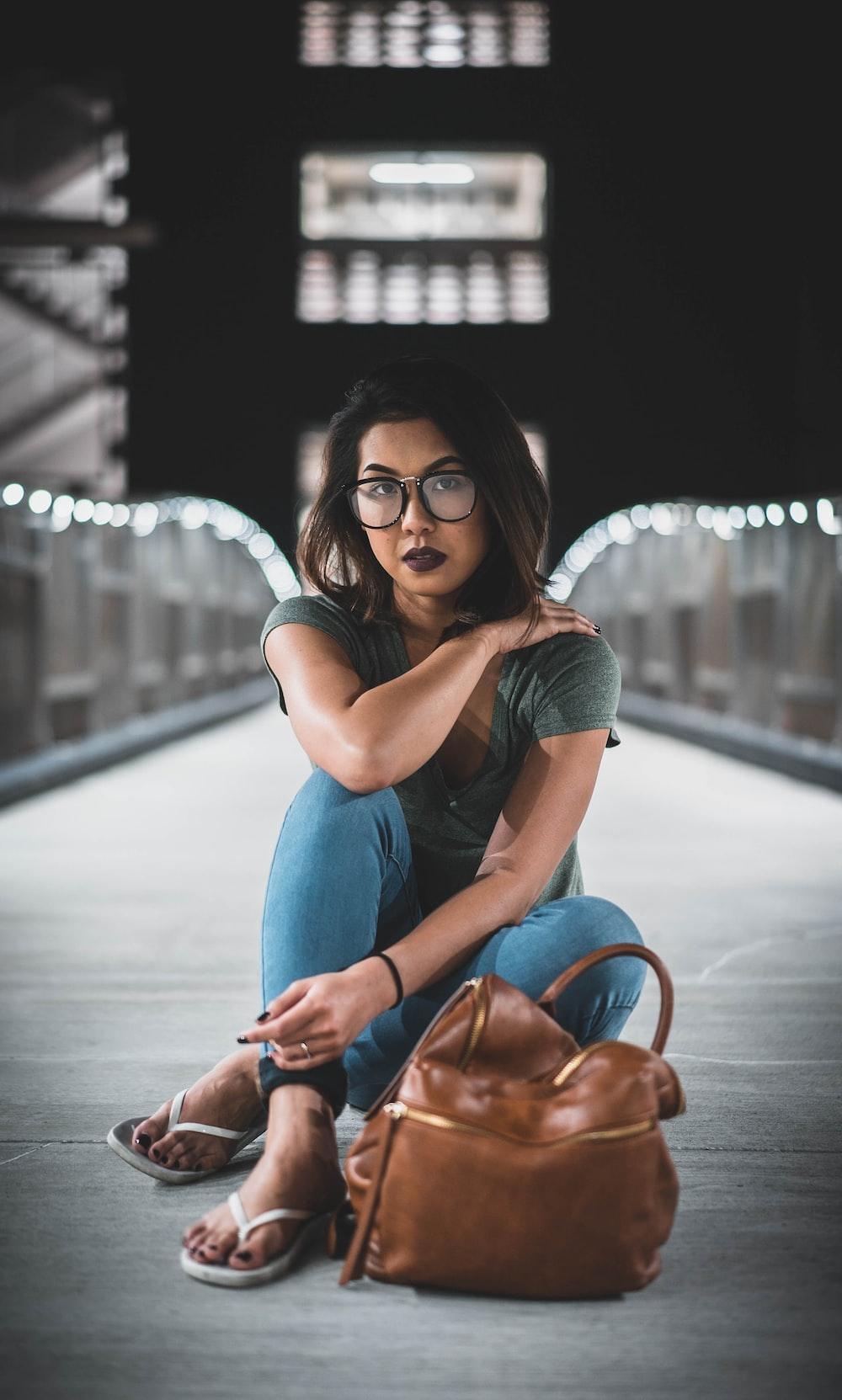 woman sitting on boat dock
