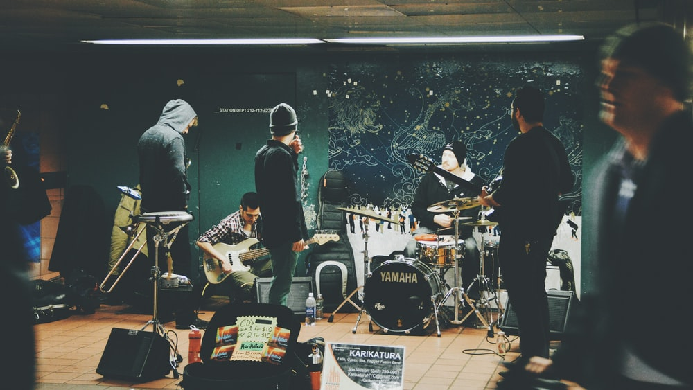 A music band preparing to perform live in the subway