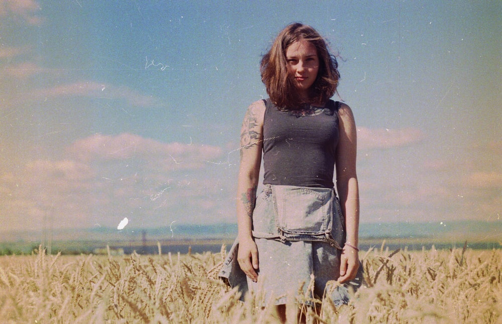 woman standing on brown field
