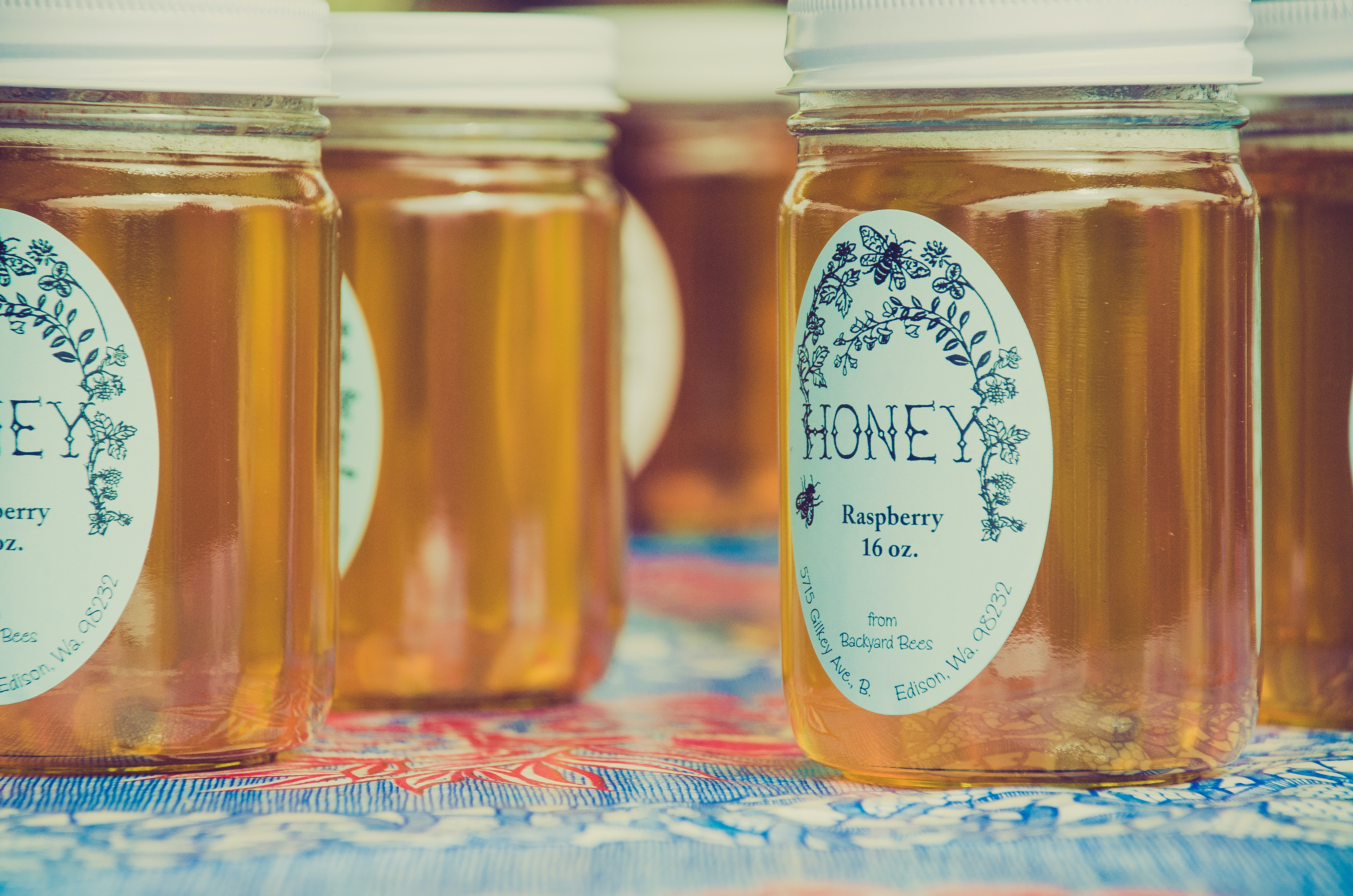 Jars of local honey with decorative labels