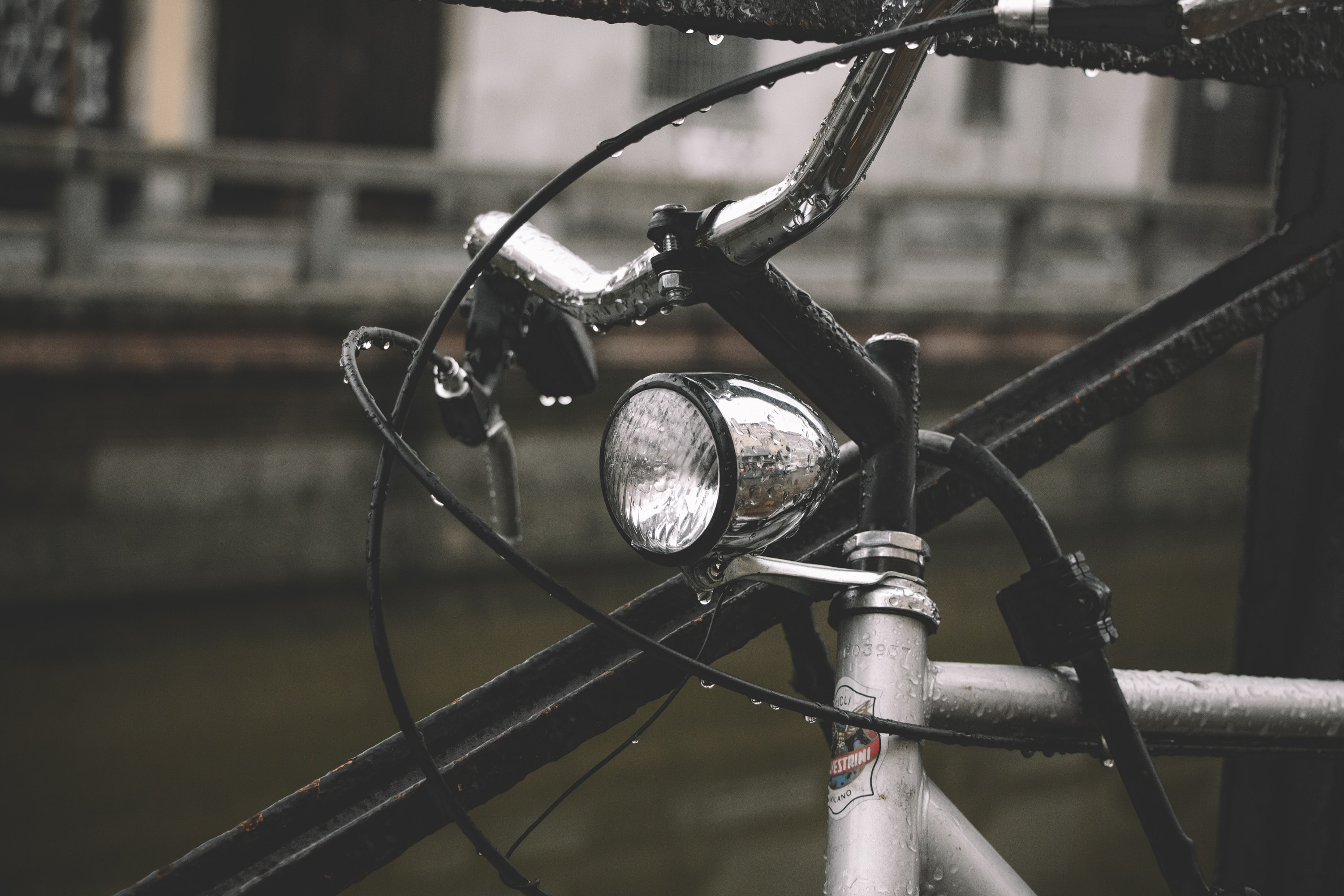 Headlight on a bicycle on a rainy day in the city