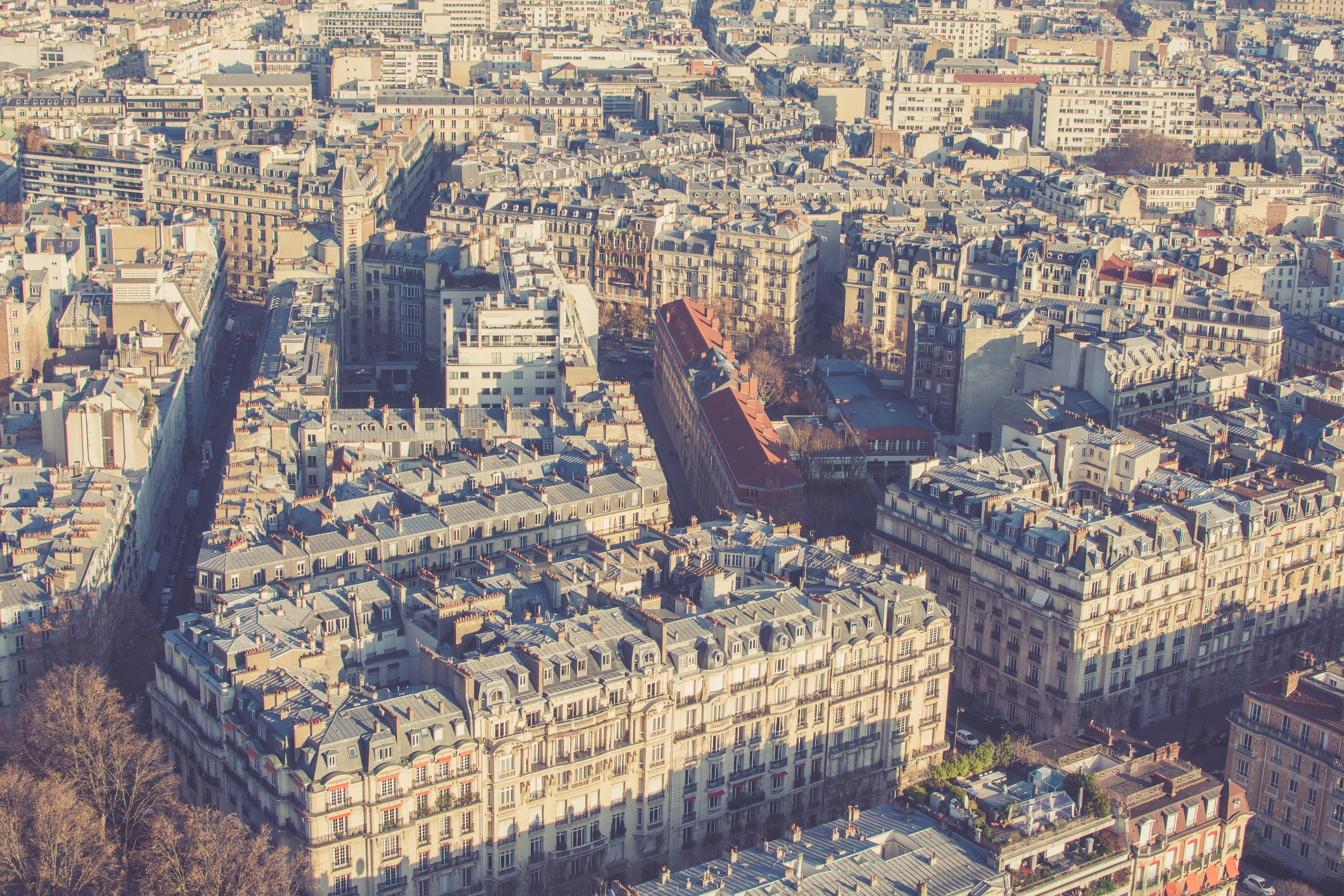 A drone shot of Paris buildings with sepia tone