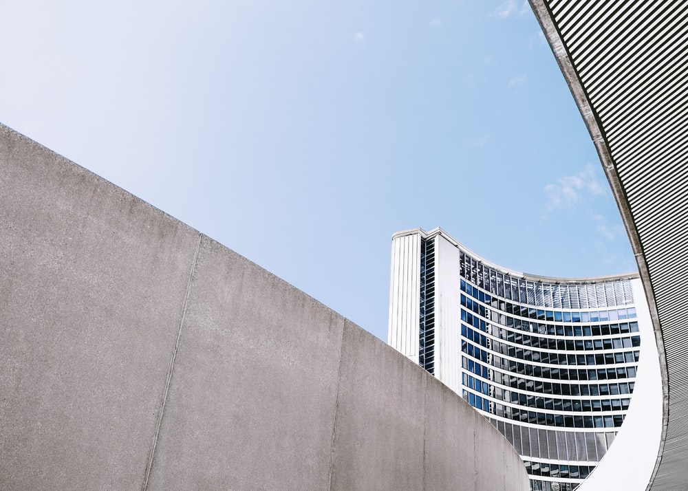 Concrete walls near the curved building of Toronto City Hall