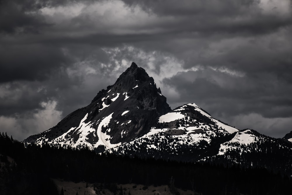 silhouette photo of mountain covered with snow
