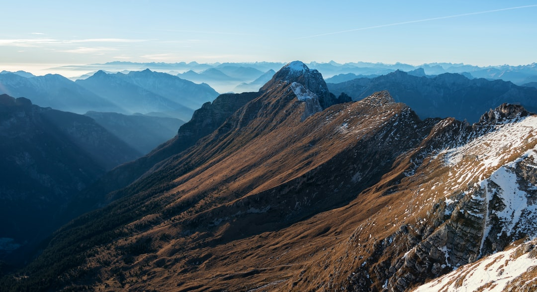 Sunset in the mountains above Pecol meadow in Italy above mountain pass Sella Nevea.
