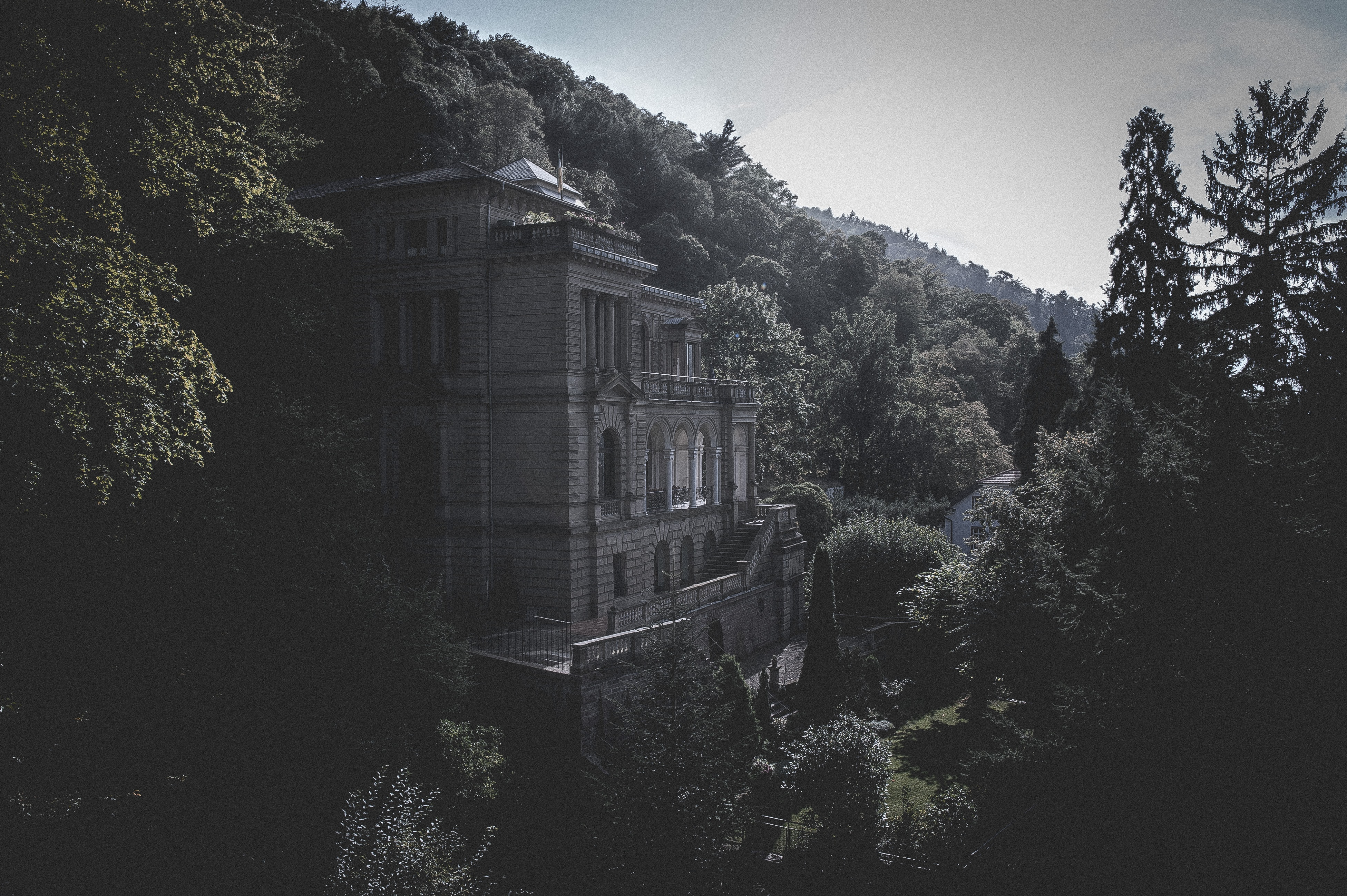 A historic building in neoclassical style surrounded by woods in Heidelberg