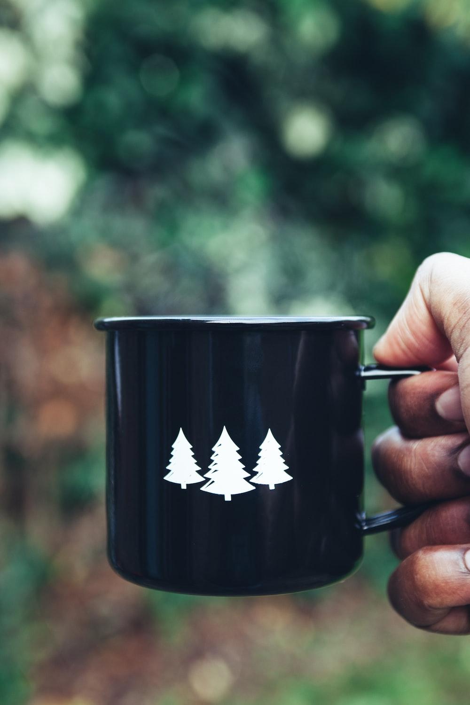 selective focus photography black and white mug