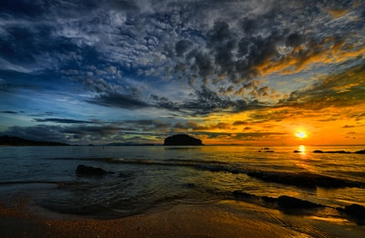 Richly colored sky over calm sea water