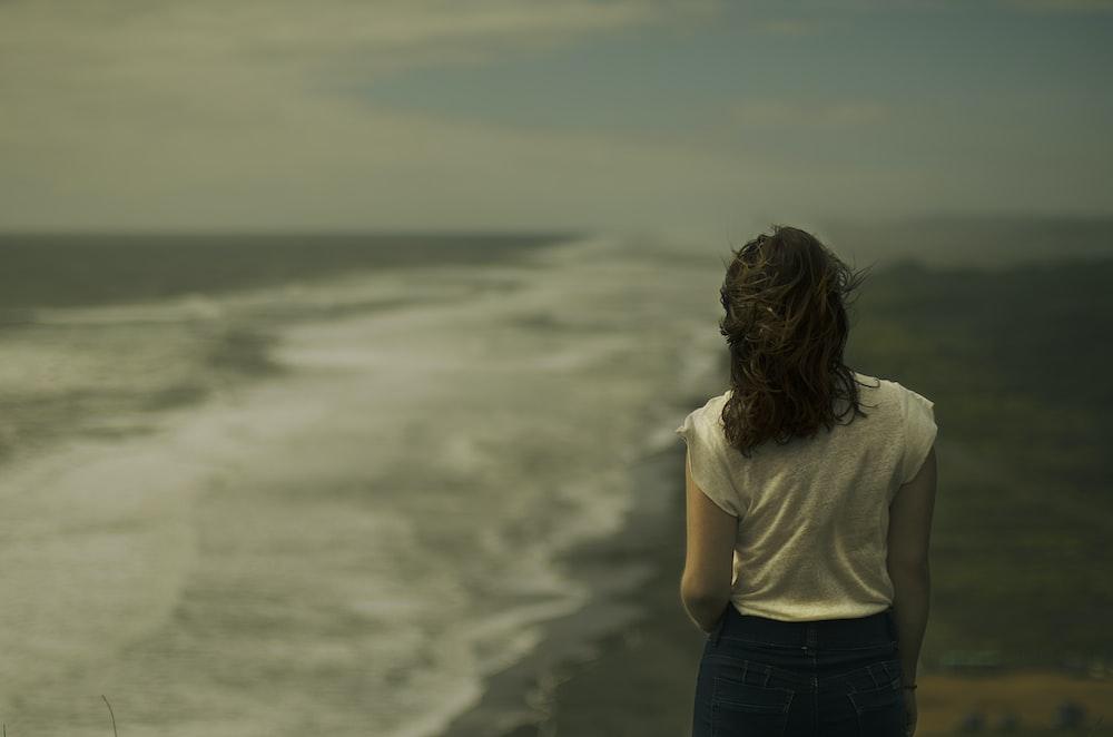 woman standing near seashore