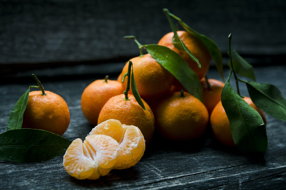 oranges on top of gray wooden table