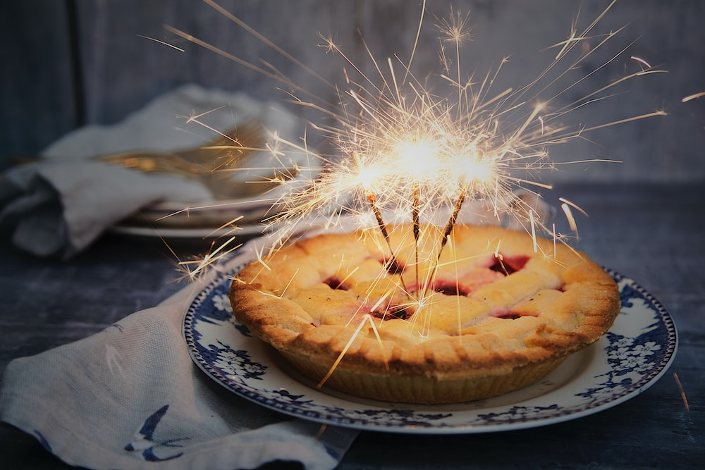 brown pie with sparklers on top