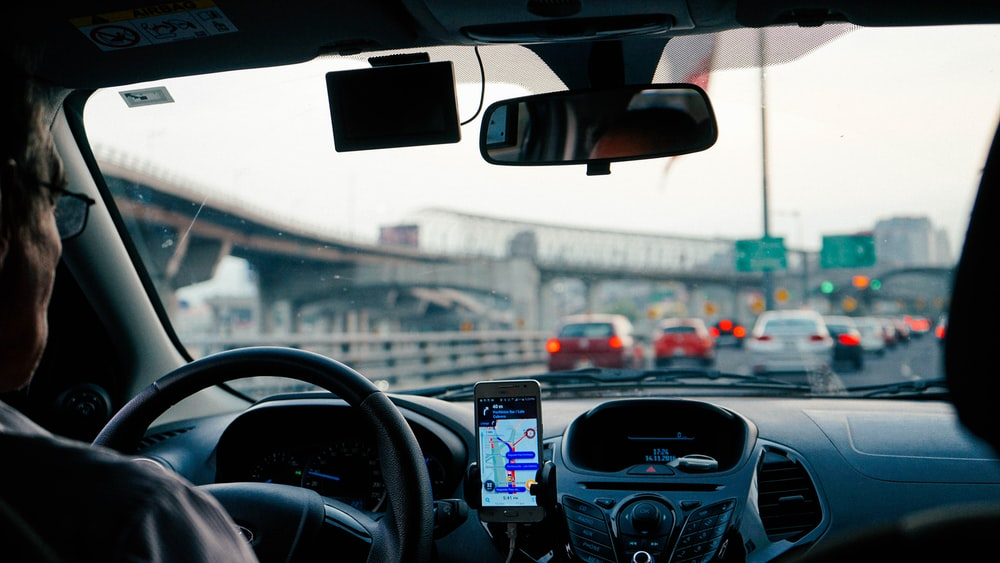 man driving vehicle with GPS system turned on