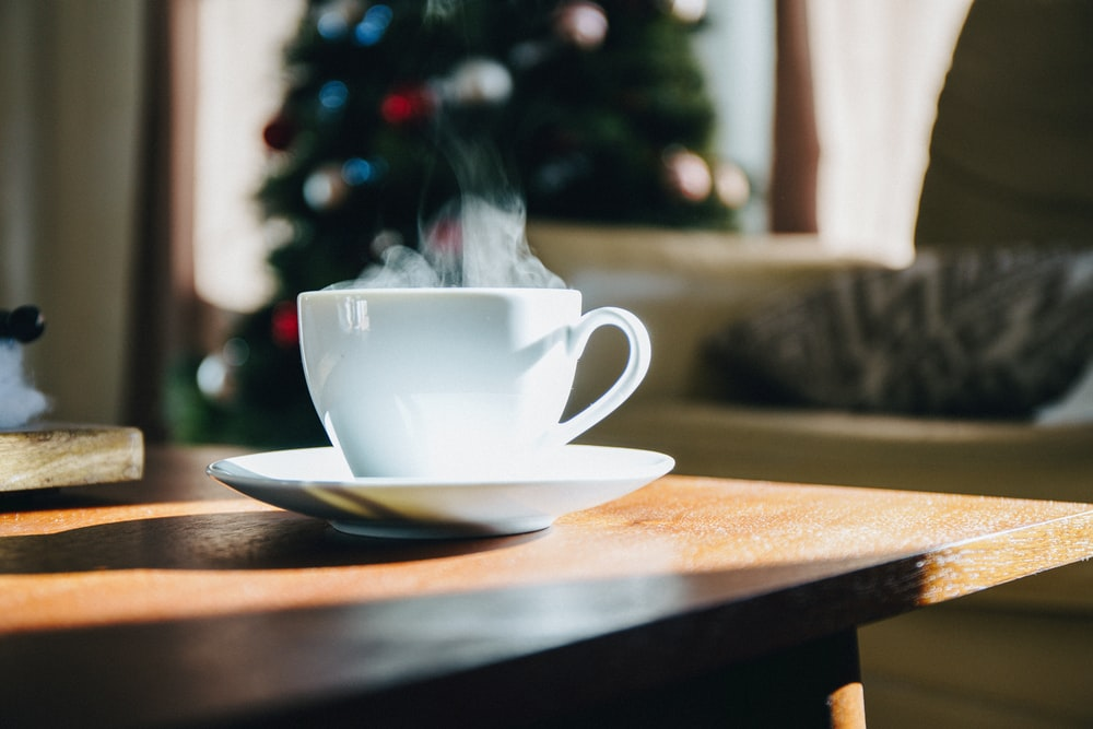white teacup on top of brown table