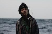woman in jacket near sea