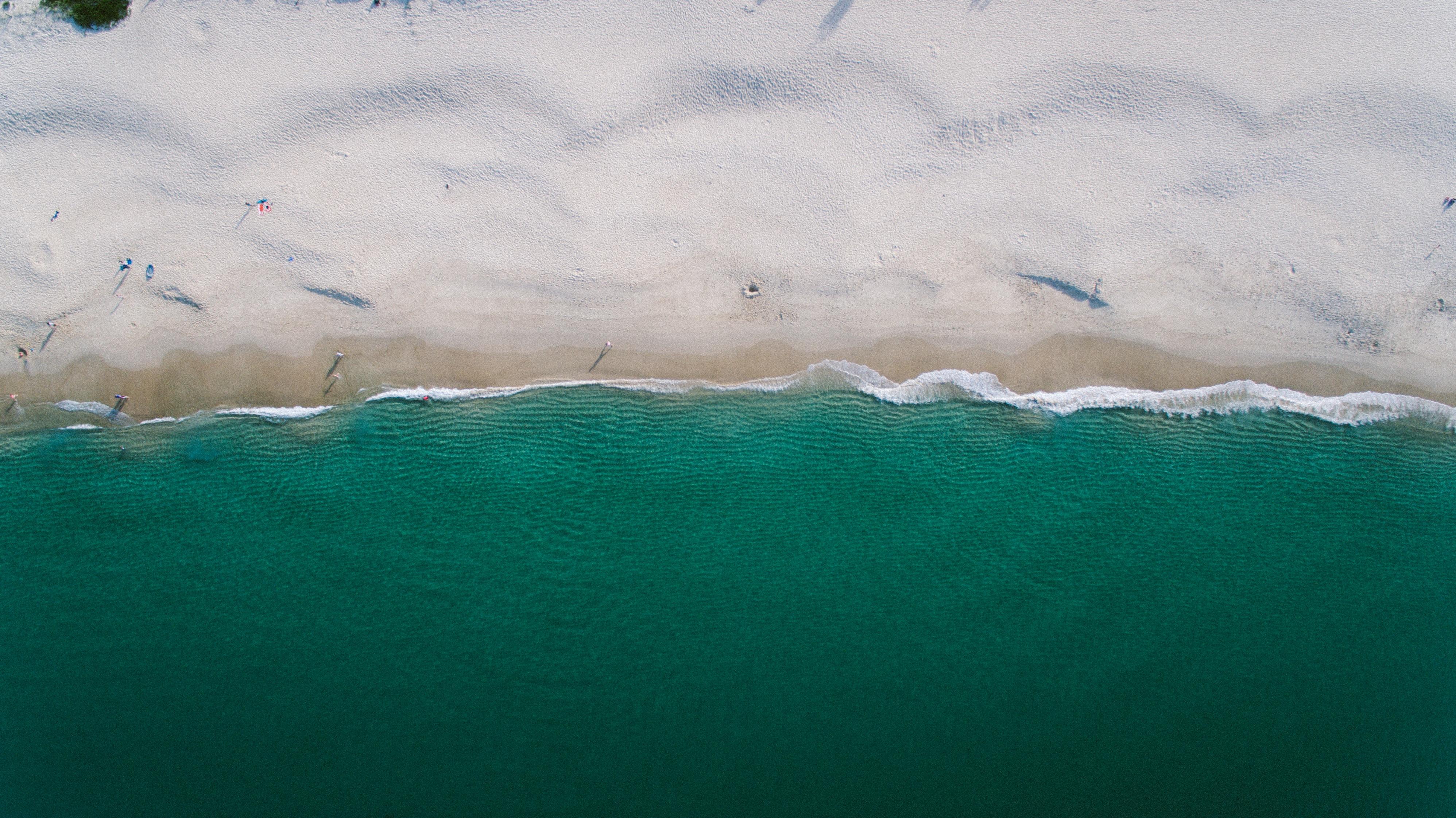 gray sand next to beach