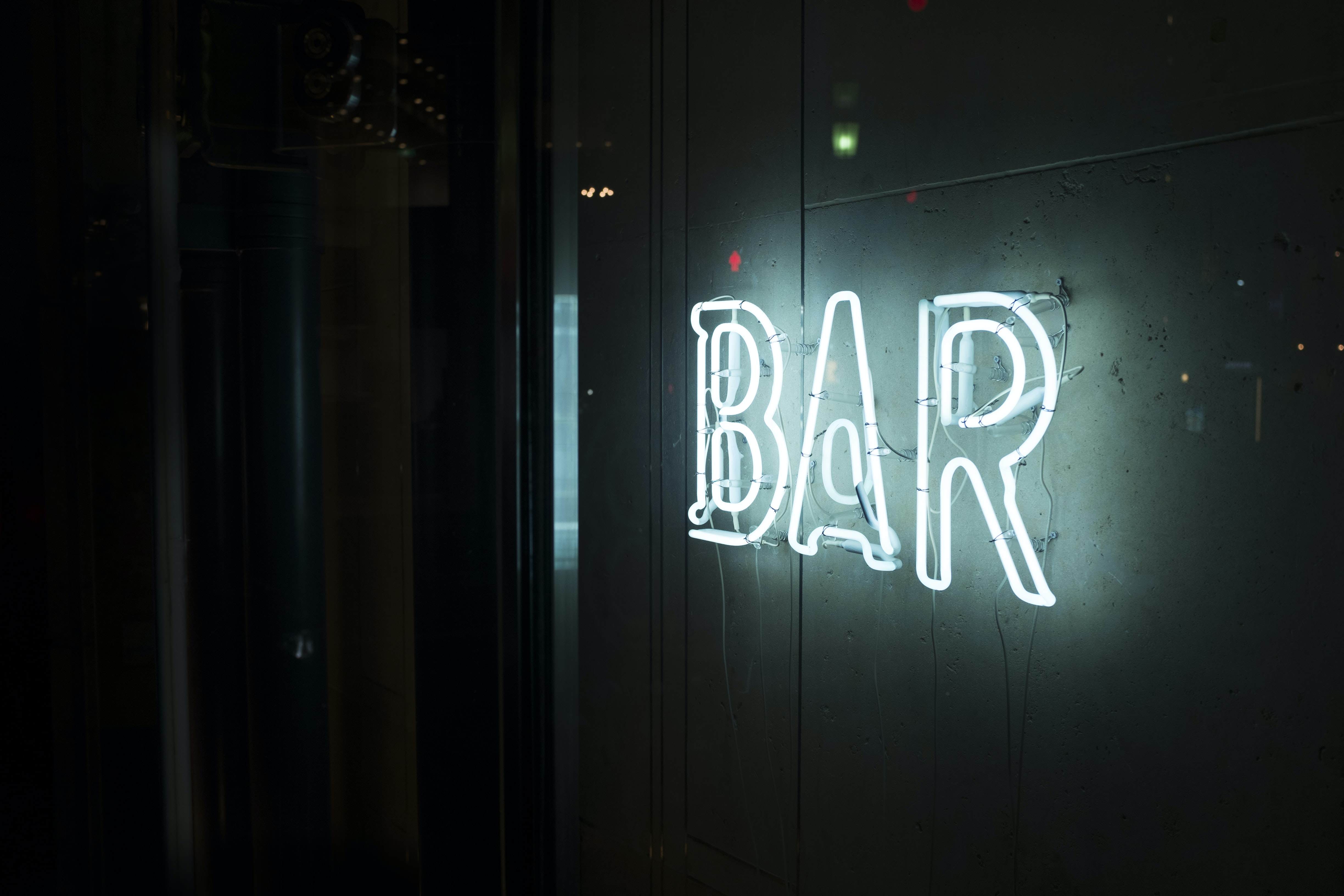 photo of turn-on white bar neon sign