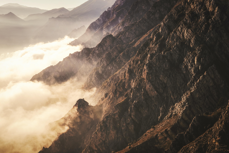 Fog rolls in on a mountain ridge in Pregasina