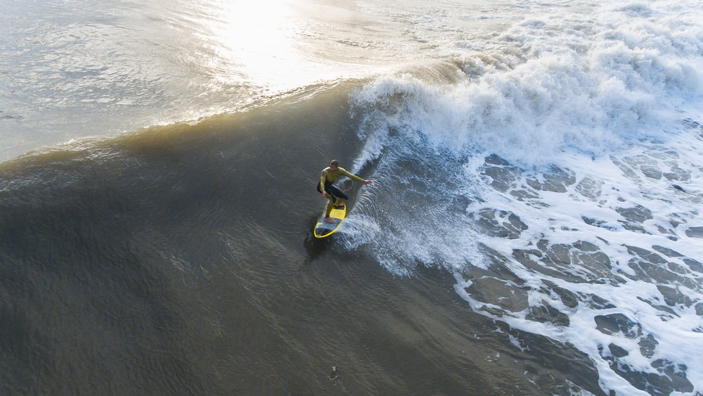 man surfing on waves