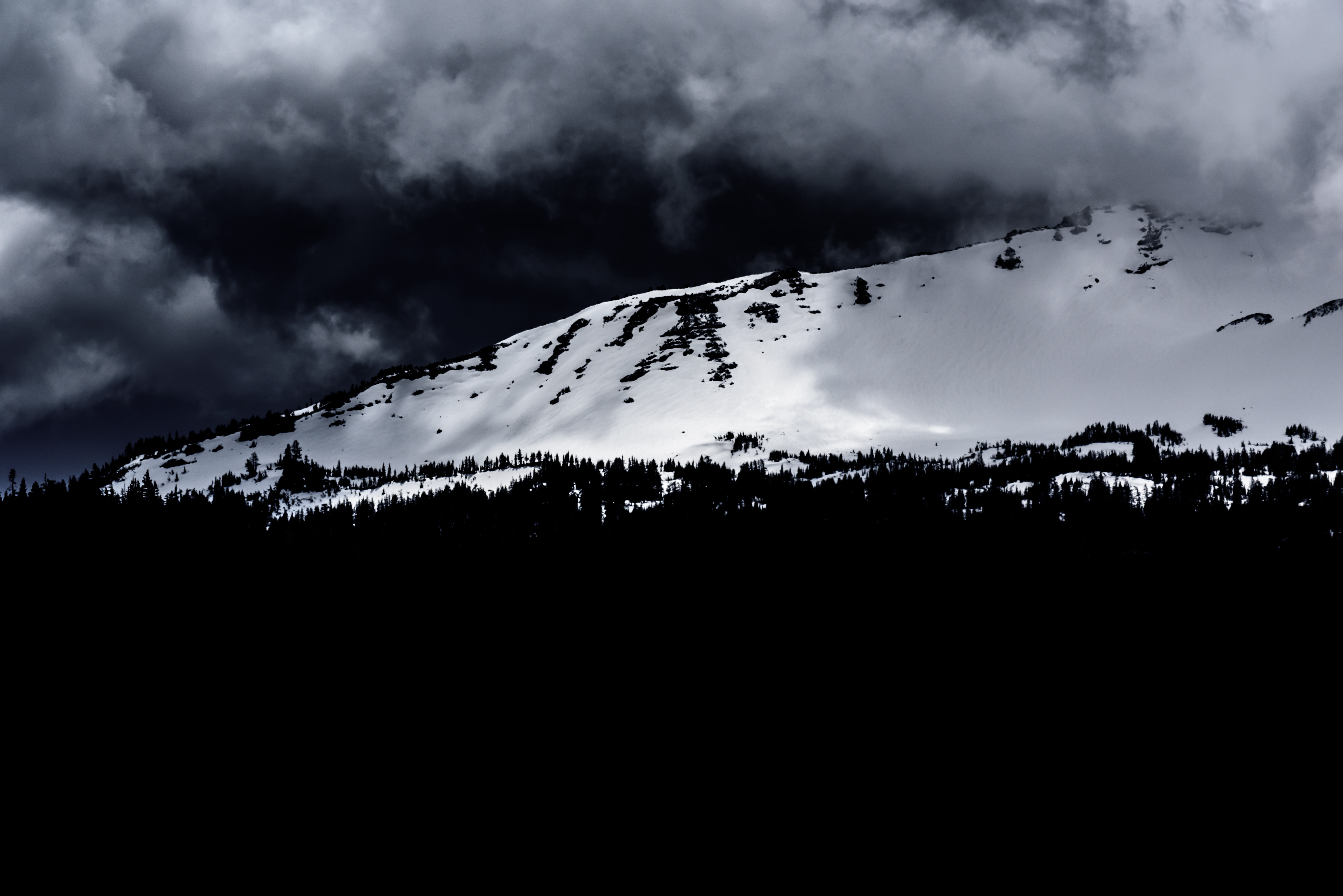grayscale photo of mountain during winter