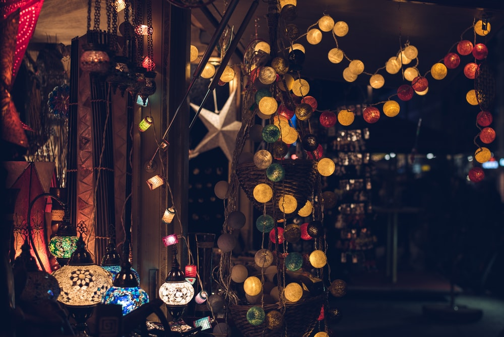 Round Christmas lights and colorful lamps in a room