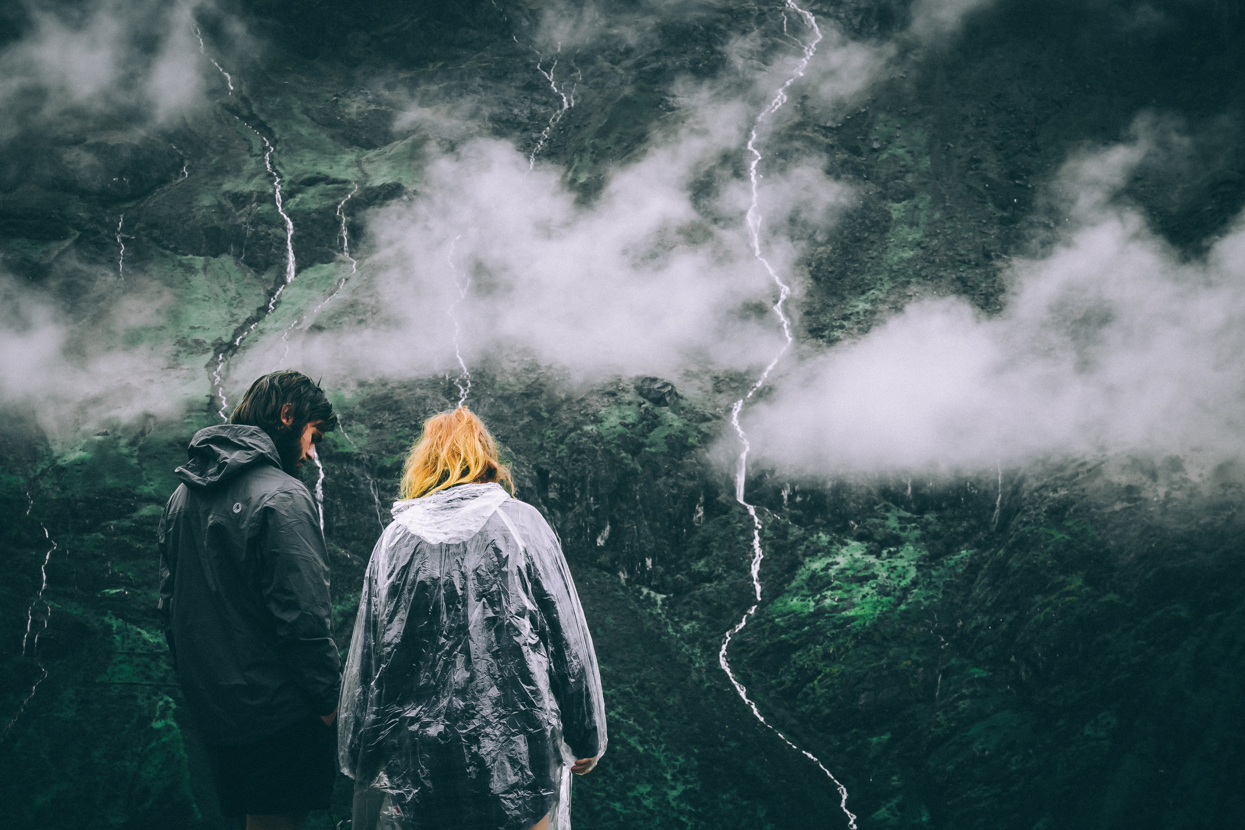 man and woman looking at mountains