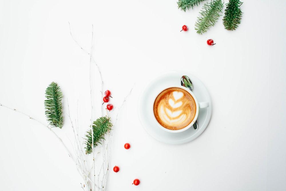white ceramic coffee mug with latte art