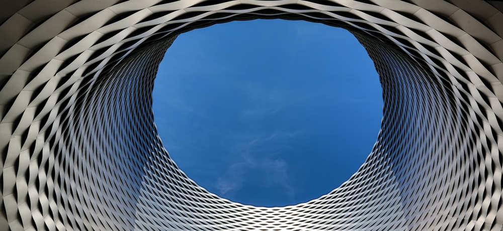 worm's eye view of blue sky