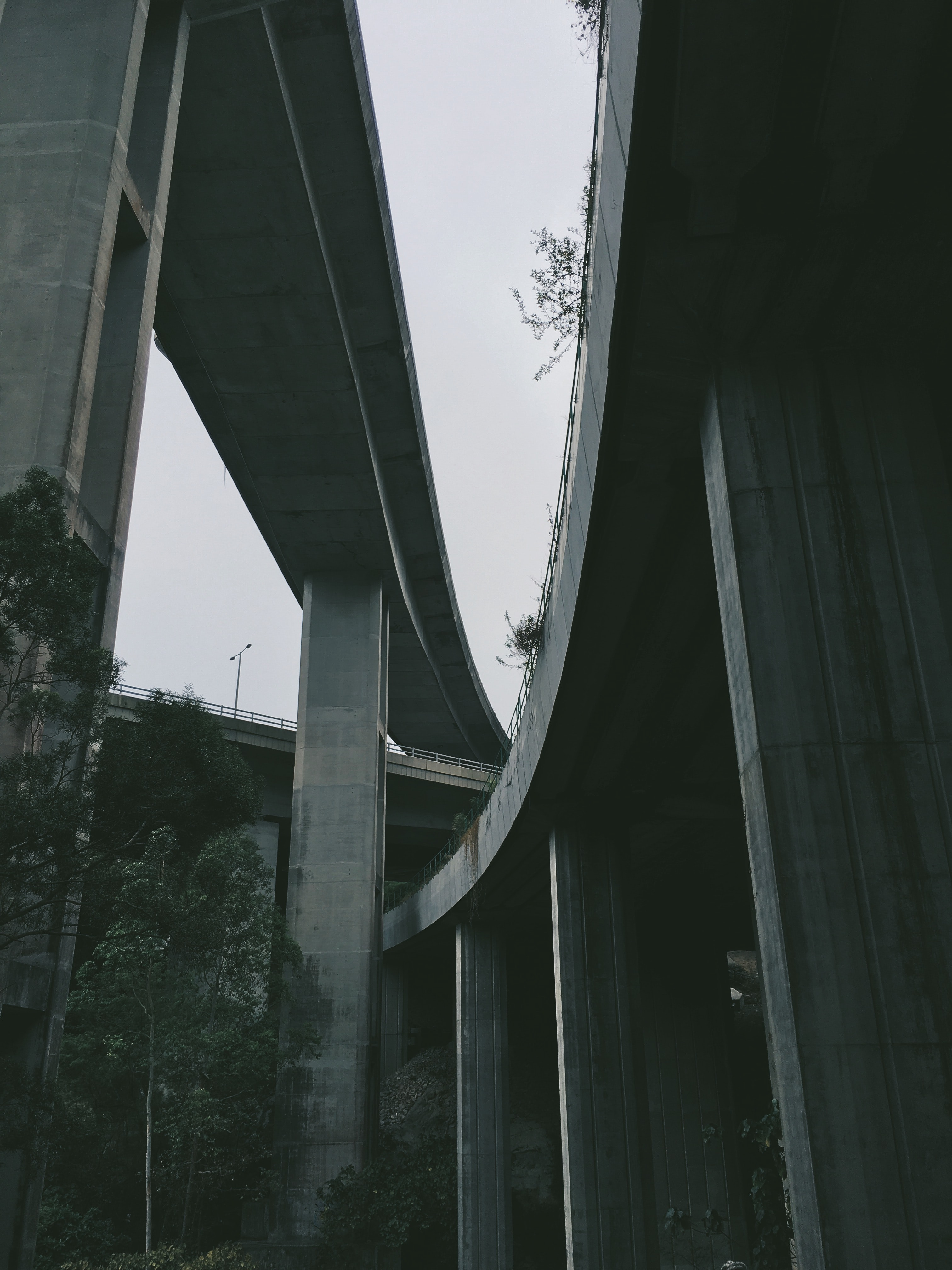 Looking up at the multiple overpasses from below in Ting Kau, Hong Kong.