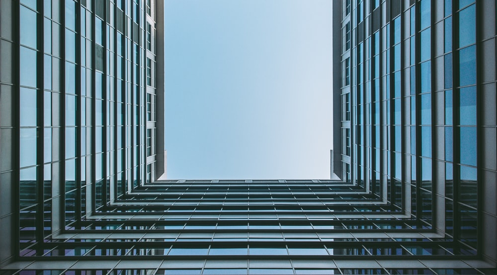 worm's eye view photography of glass building