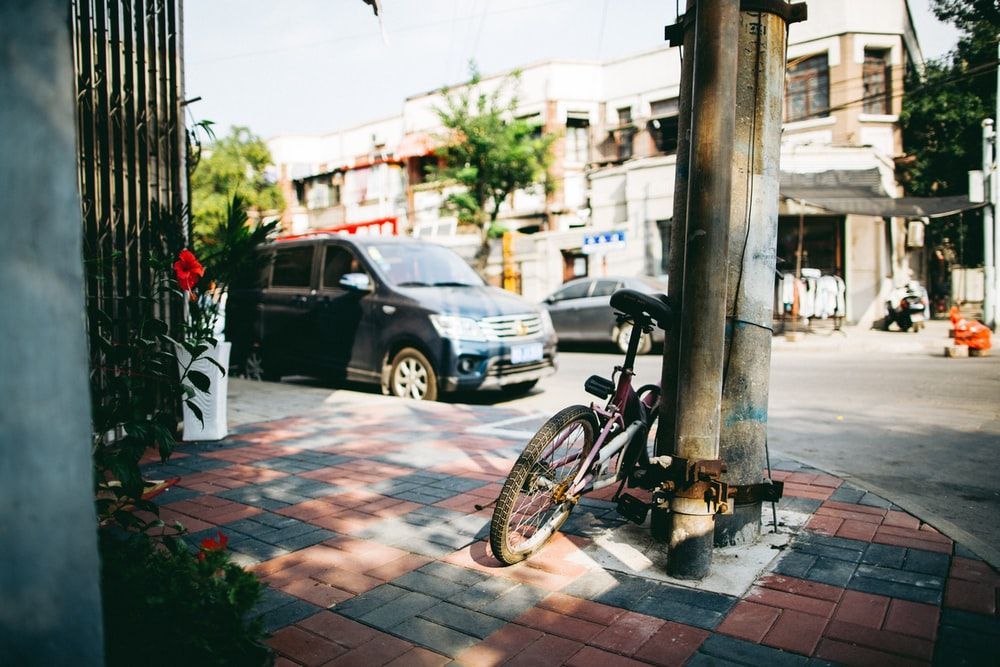 photo of bike parked on post