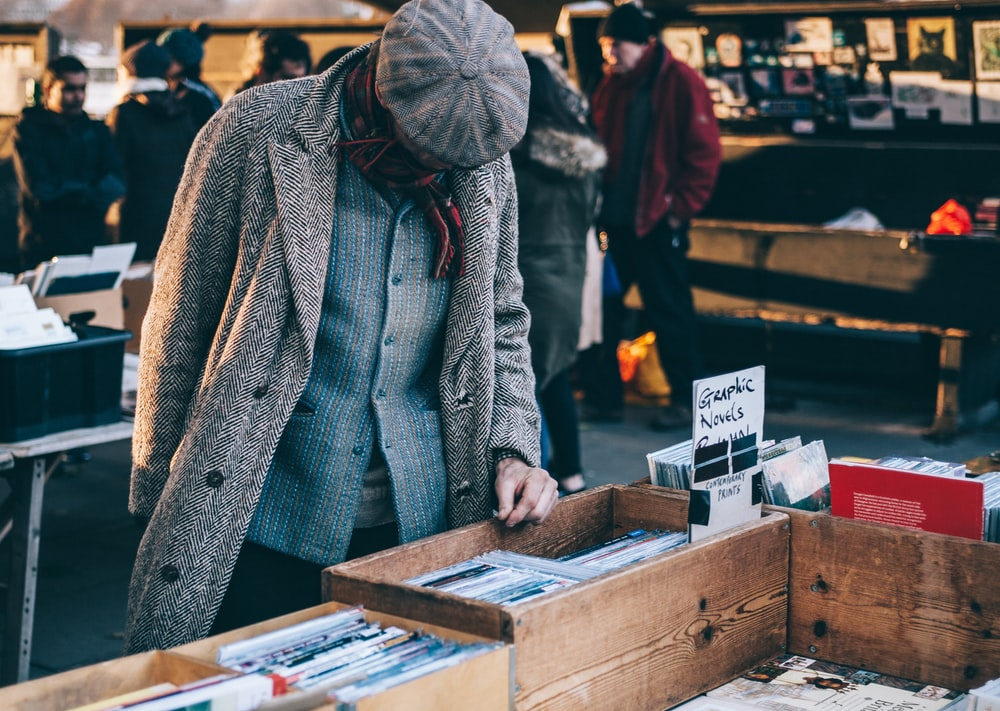 person looking in box filled with books
