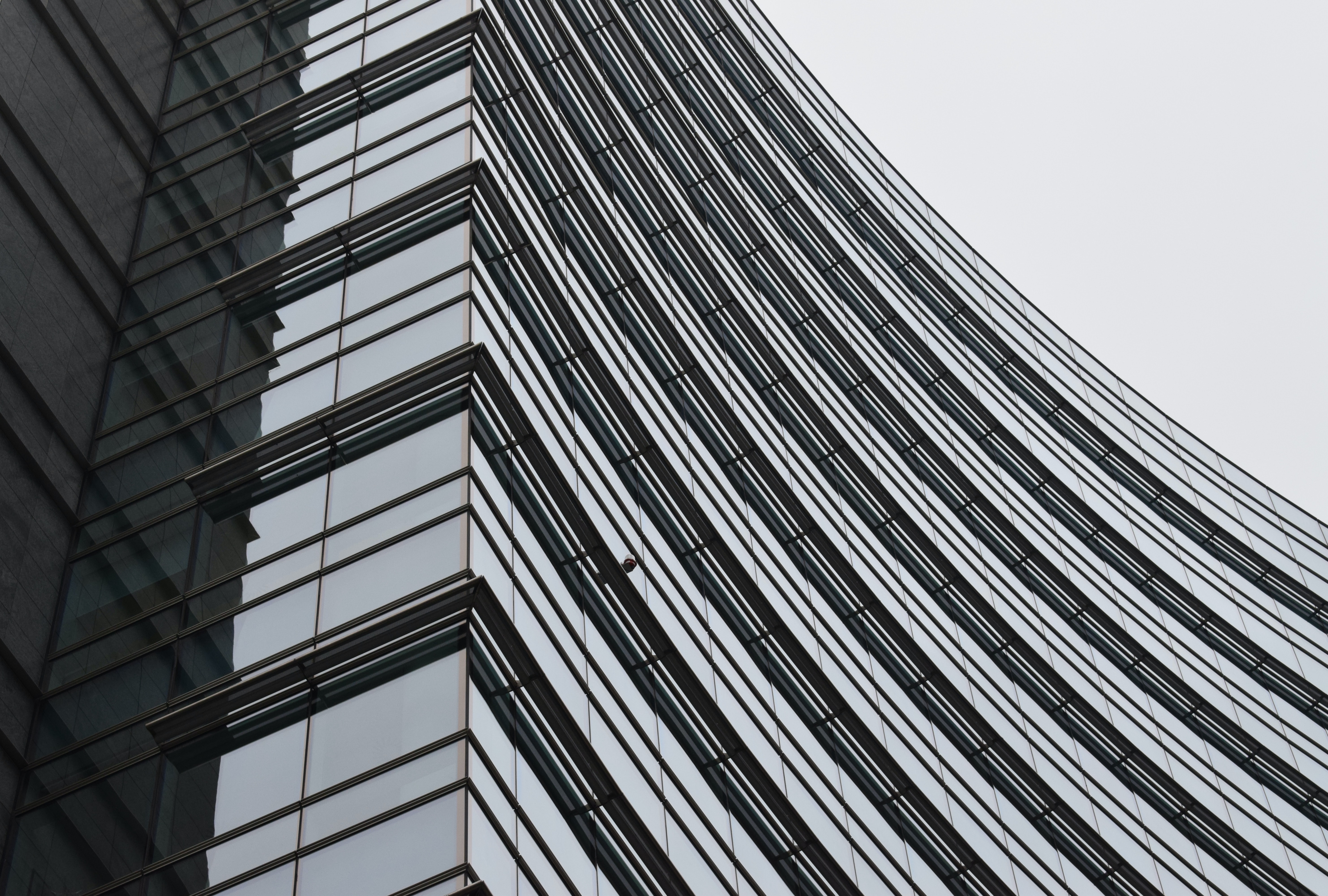 worm's eye view of tall glass building