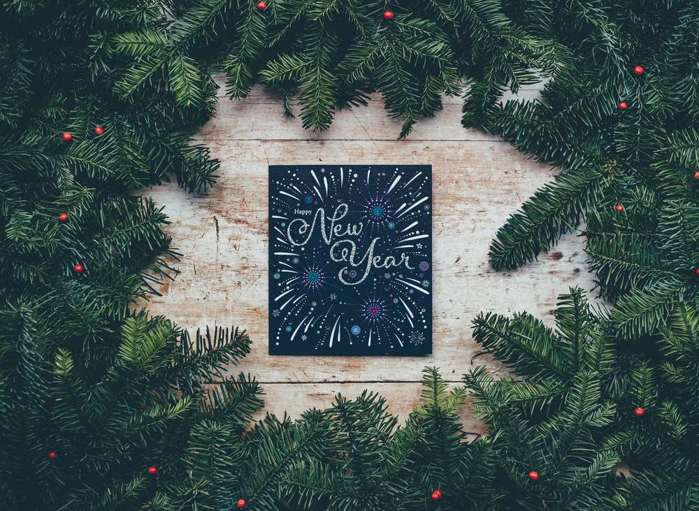 green Christmas decor with New Year greetings