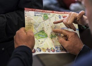 two people pointing at London's number one sightseeing map
