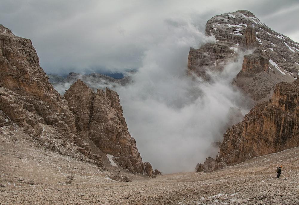 landscape photography of foggy mountain rocks