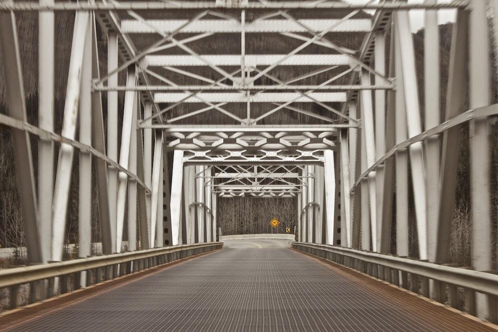 empty metal bridge during daytime