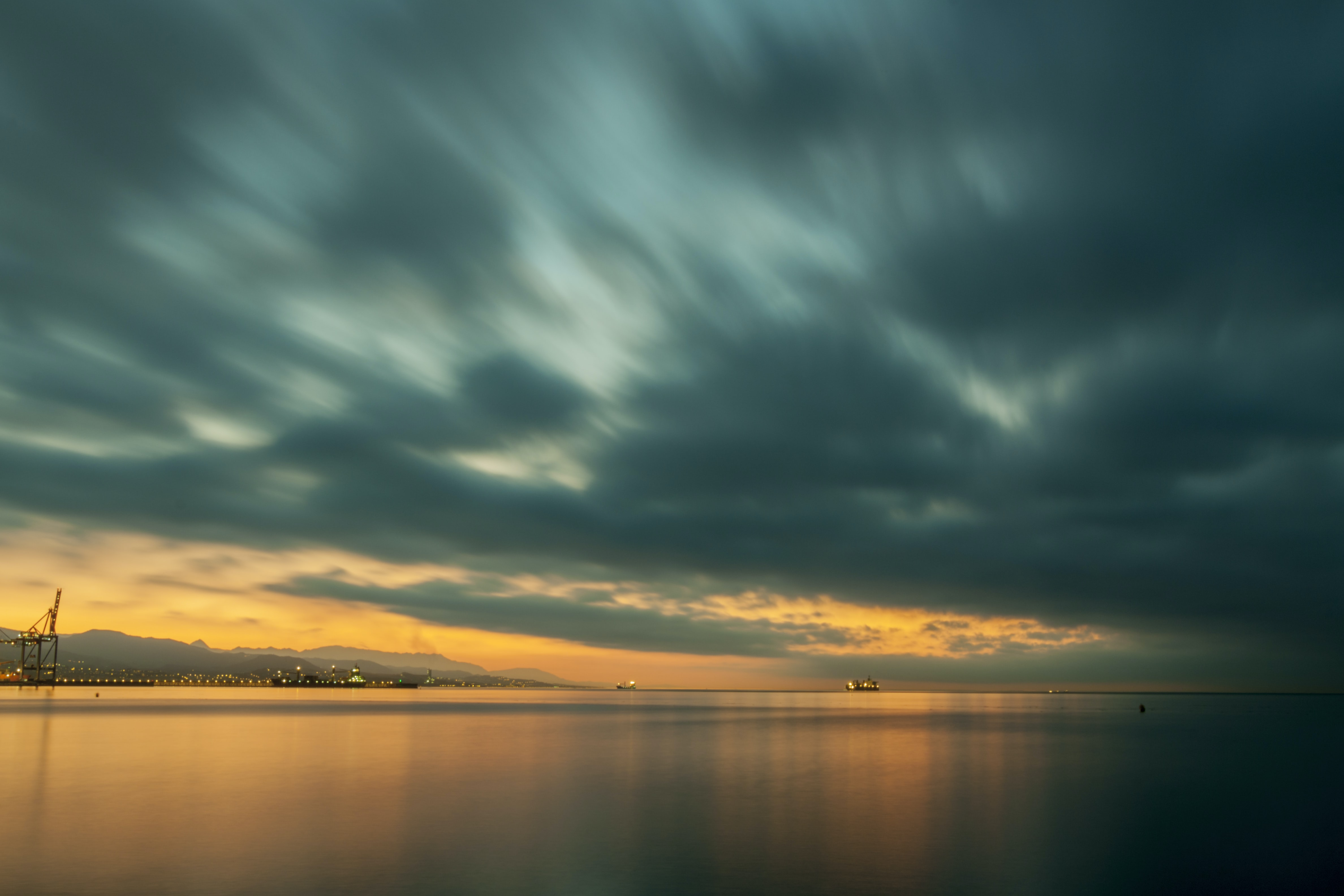 body of water under the cloudy sky