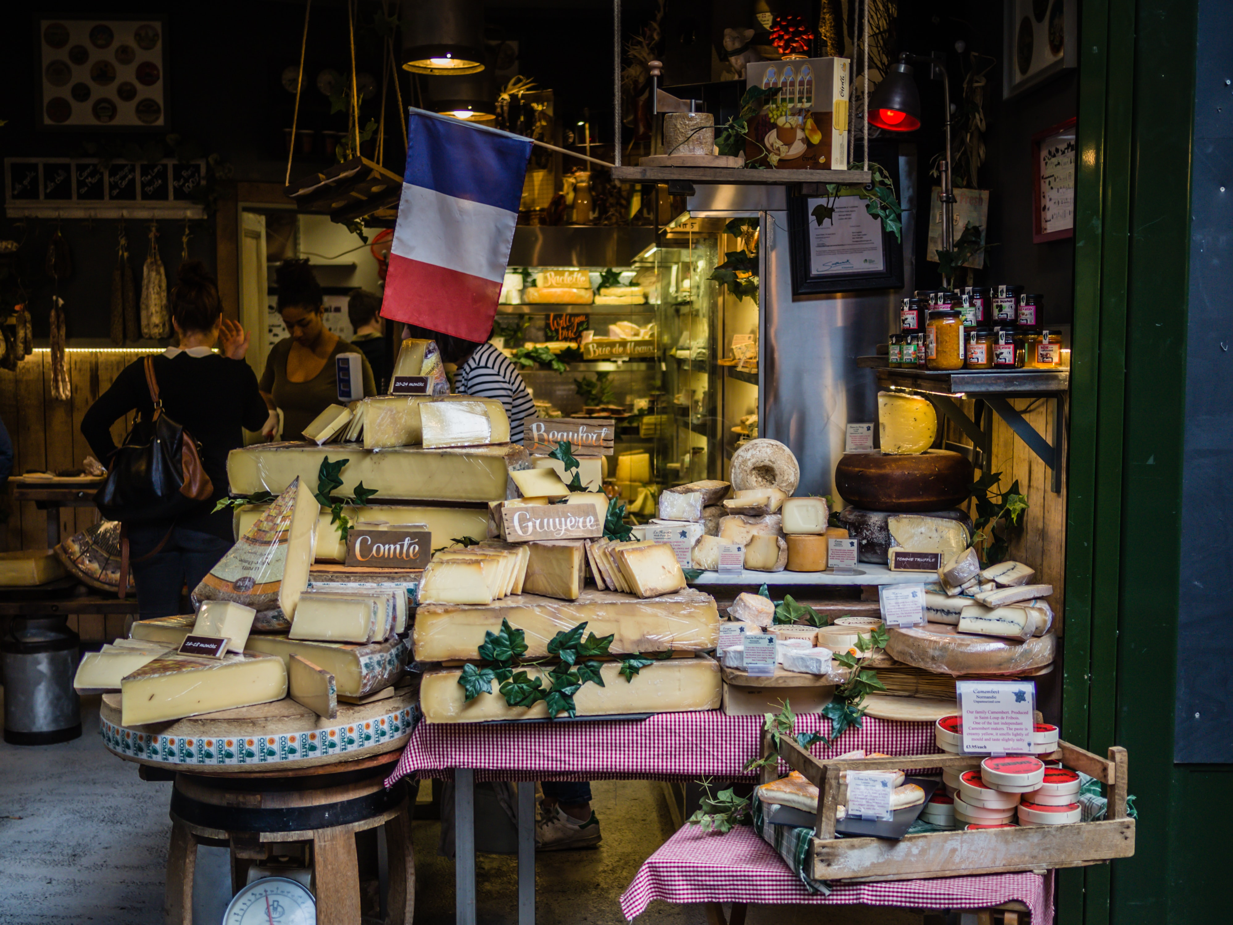 A stall with various types of French cheese