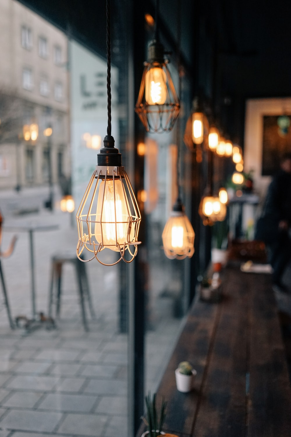 shallow focus photography of store pendant lamps