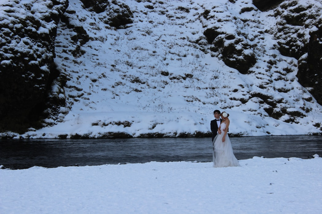 bride and groom with snowy mountain on the background