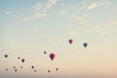 flying hot air balloons at daytime hot air balloon teams background
