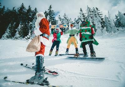 santa claus riding snowboard elf teams background