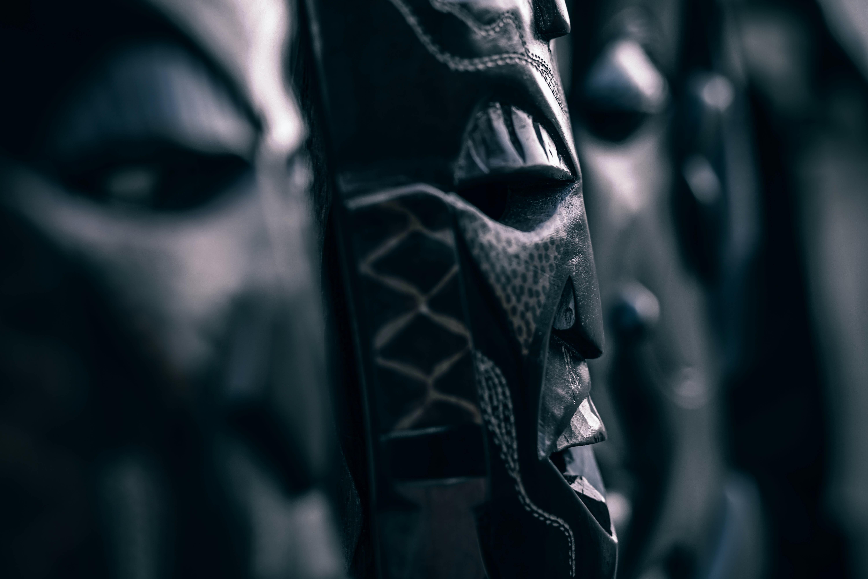 selective focus photograph of black tribal mask decor