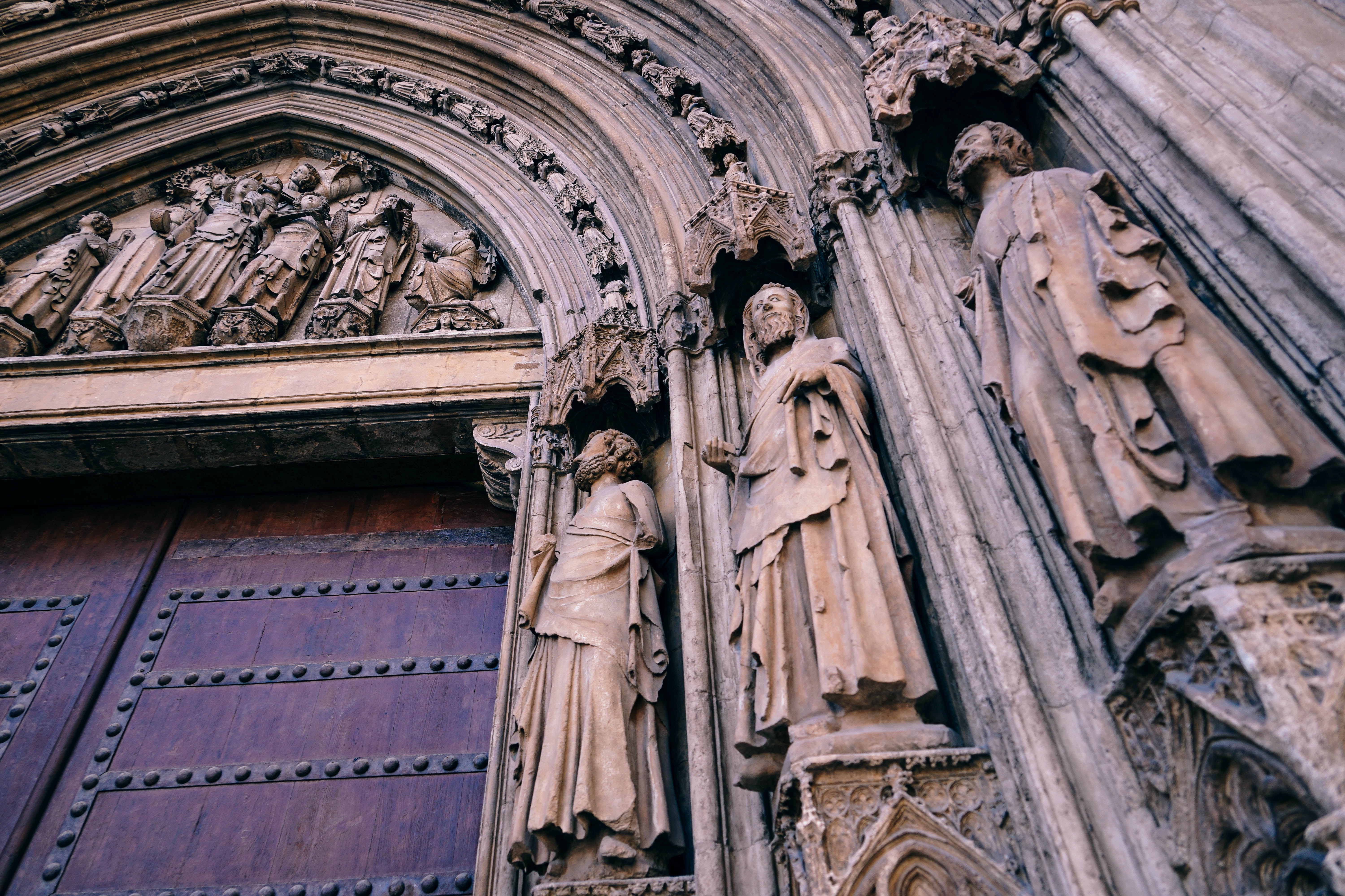 Carved statues on the front wall of a church.
