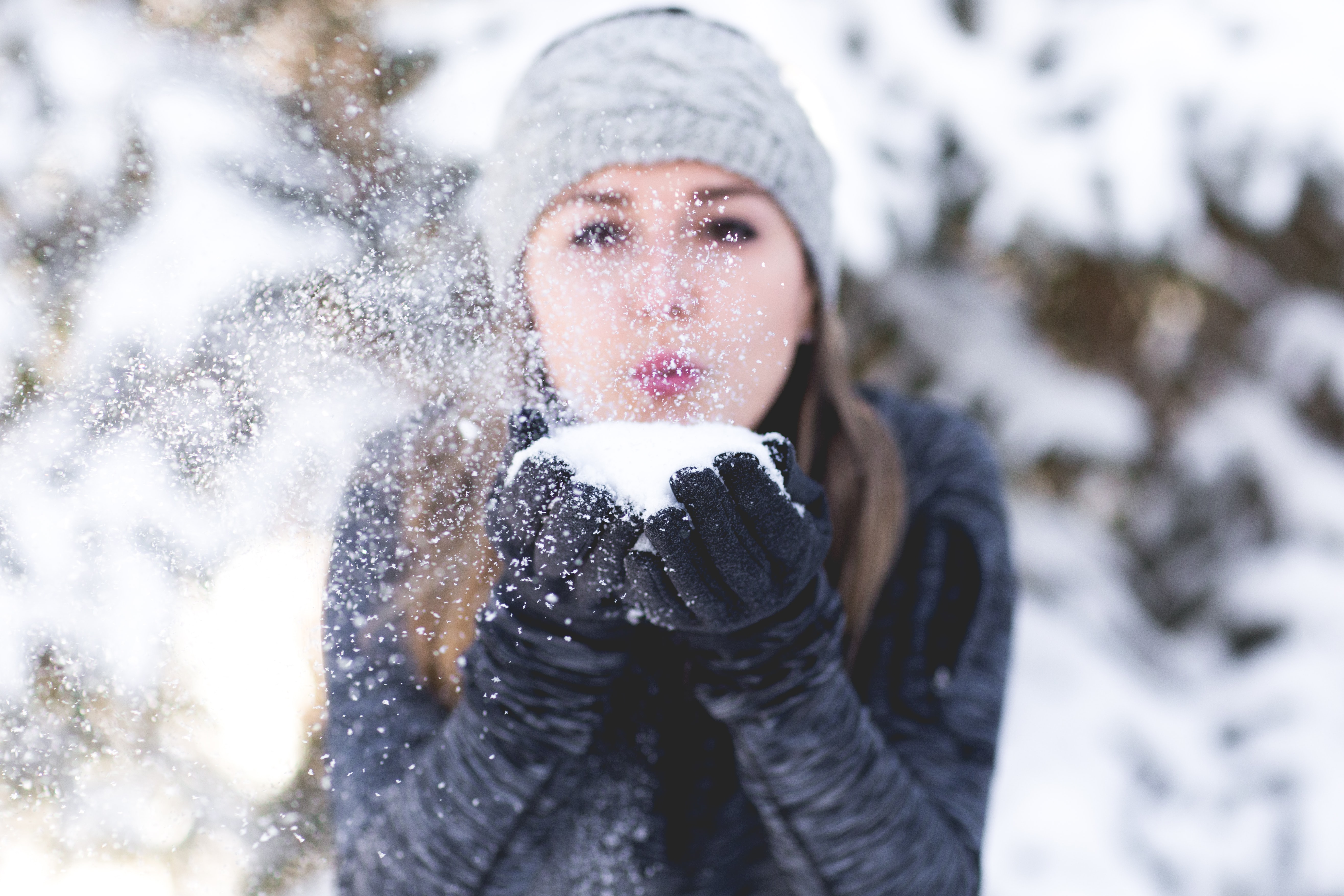 woman wearing jacket and holding snow
